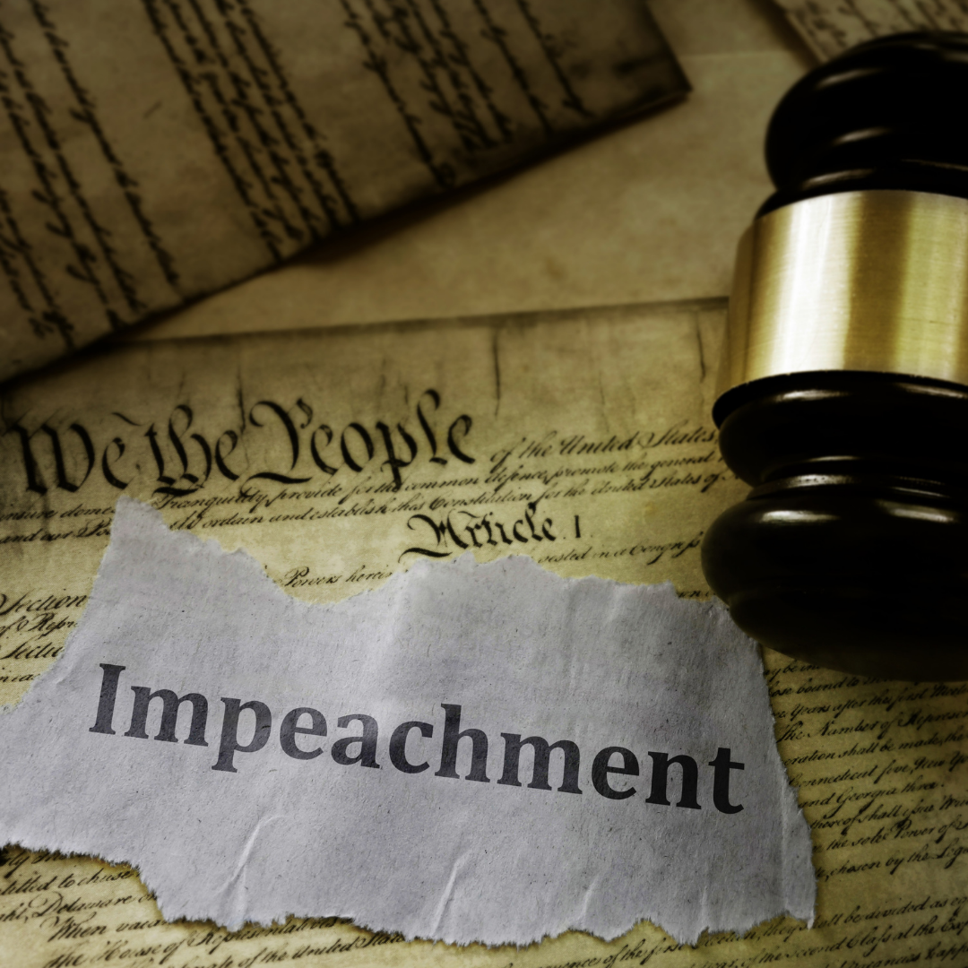Photo of the Word Impeachment on the Constitution next to a gavel