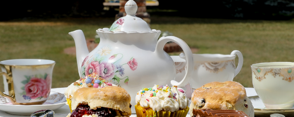 Photo of Tea Pot and Pastry