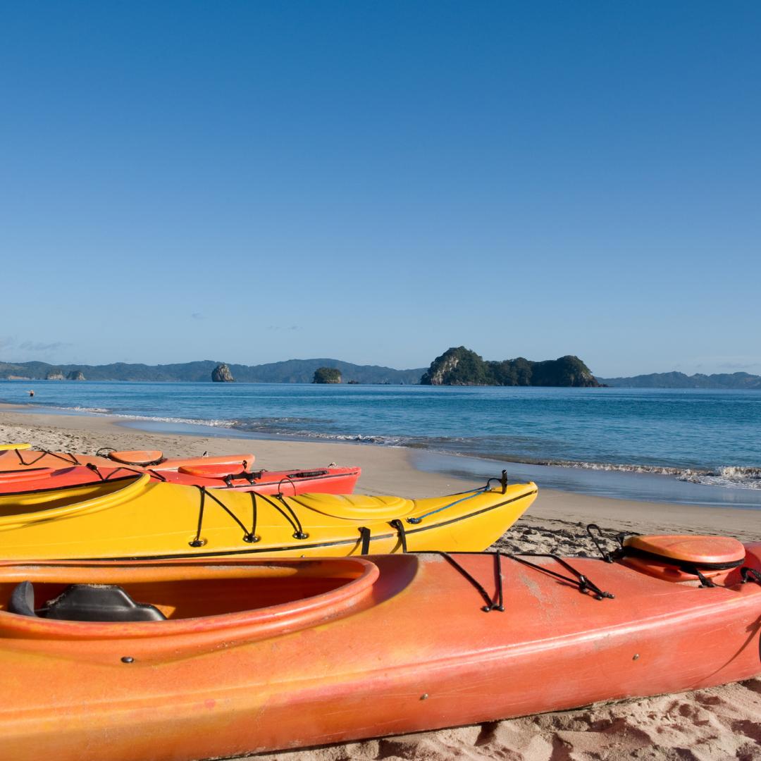 Photo of kayaks on a beach